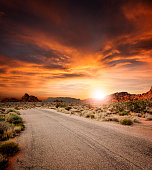 Beautiful desert Road at sunset. Large composite.