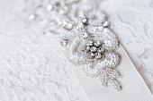 Beautiful details of a wedding dress beadwork close-up