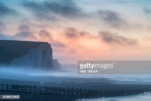 Beautiful dramatic foggy Winter sunrise Seven Sisters cliffs lan : Stock Photo