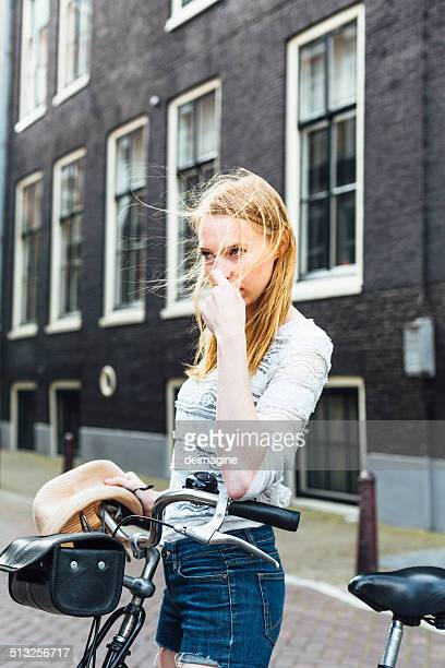 Beautiful Dutch blonde woman with bike