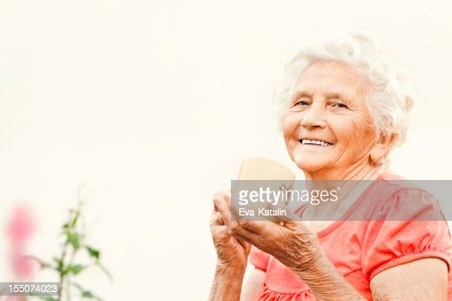 Beautiful elderly lady drinking tea