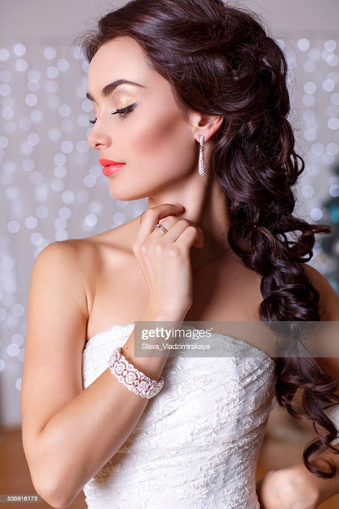 beautiful elegant bride with dark hair posing at studio : Stock Photo