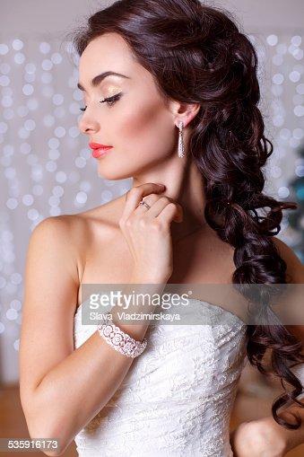 beautiful elegant bride with dark hair posing at studio : Stock Photo