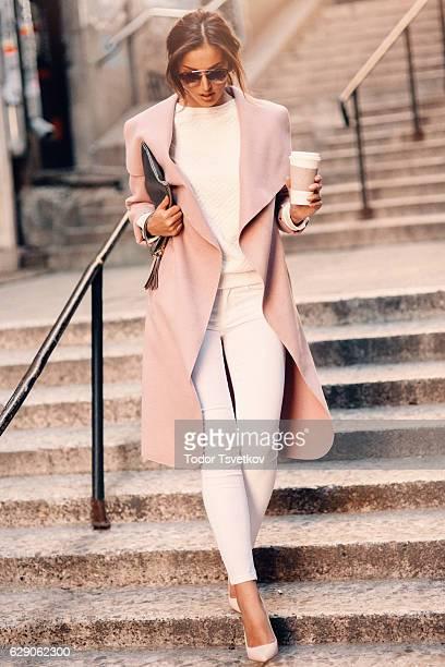 Beautiful elegant woman drinking coffee