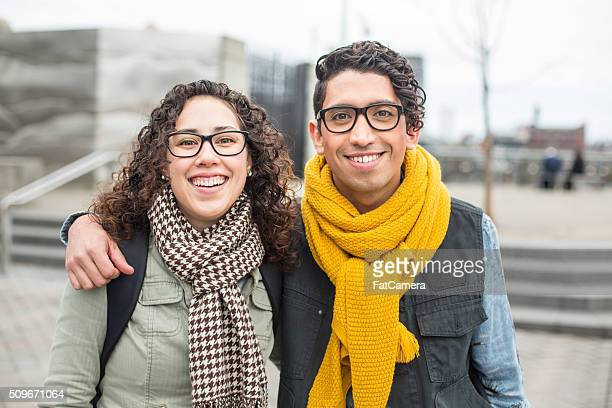 Beautiful ethnic couple enjoying the cold weather and city life