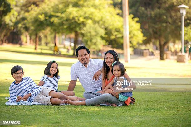 Beautiful ethnic family enjoying a day at the park