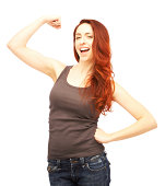 Beautiful excited redhead woman flexing her muscles