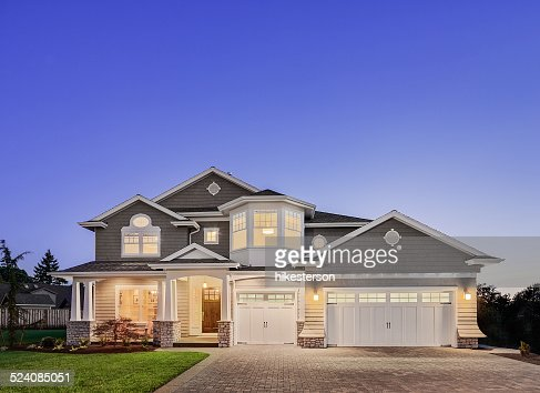 Beautiful Exterior of New Luxury Home at Twilight : Stock Photo