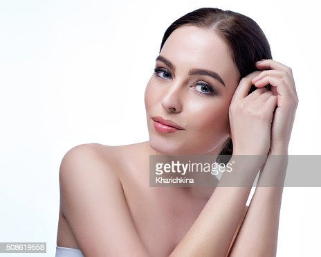 Beautiful face of young adult woman with clean fresh skin : Stock Photo