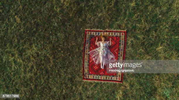 Beautiful fairy lying down on the rug