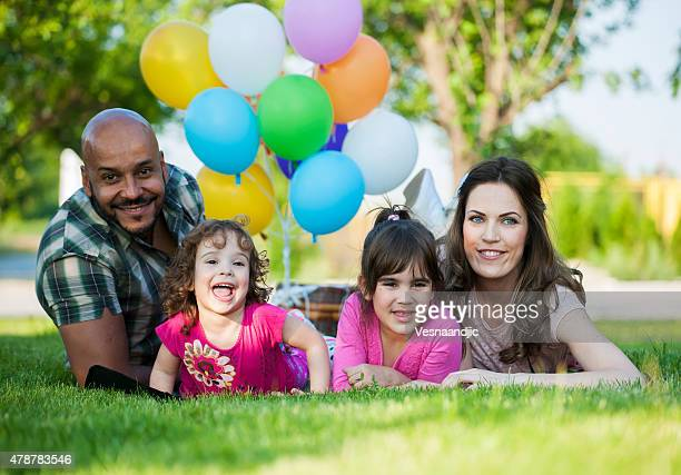 Beautiful family at picnic playing with balloons