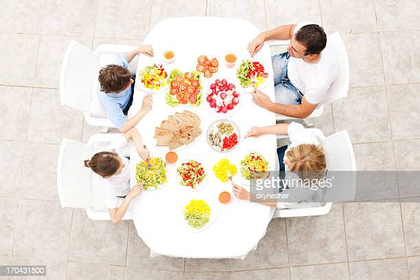 Beautiful family eating together outdoor.