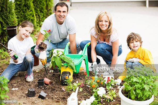 Beautiful family enjoying in the garden work.