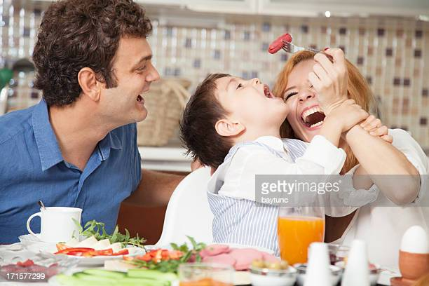 Beautiful family of three enjoying in the dinner.