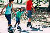 Beautiful family on roller blades, spending quality time together