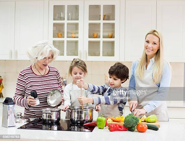Beautiful family preparing healthy food in kitchen