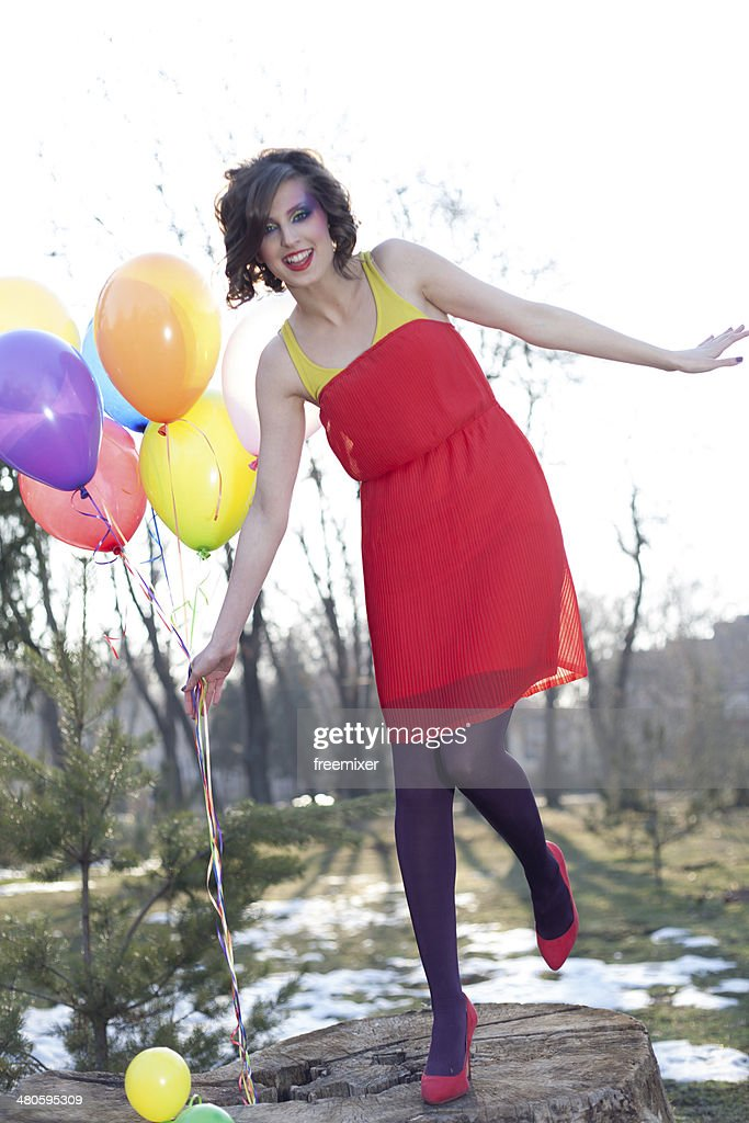 Beautiful fashion woman with balloons : Stock Photo