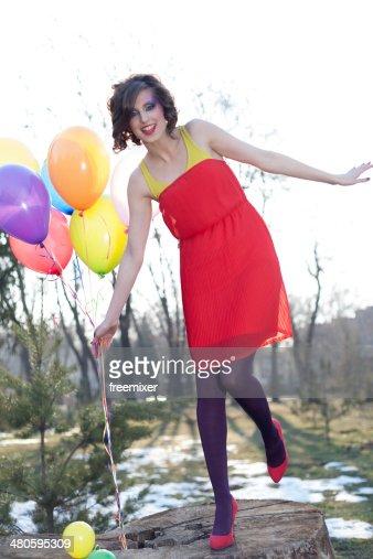 Beautiful fashion woman with balloons : Stock Photo