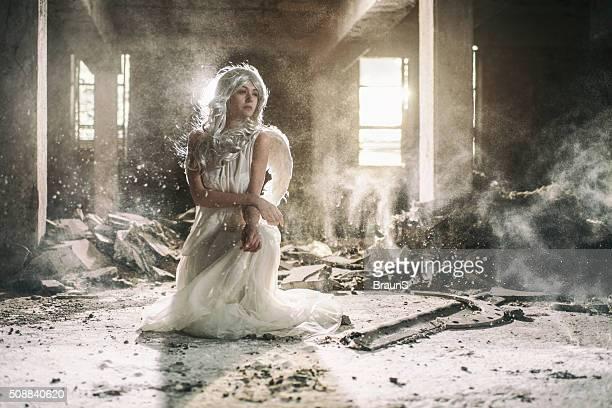 Beautiful female angel in an old ruin.