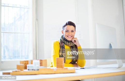 Beautiful female architect at work
