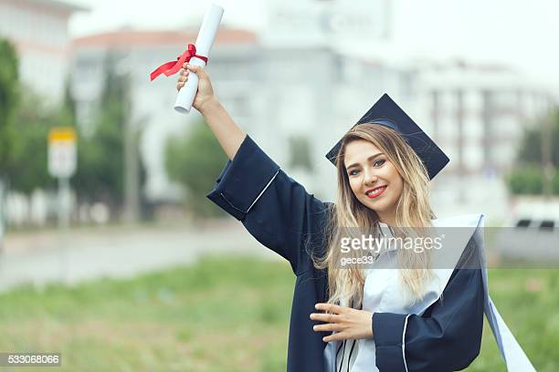 Beautiful Female College Graduate Holding Diploma