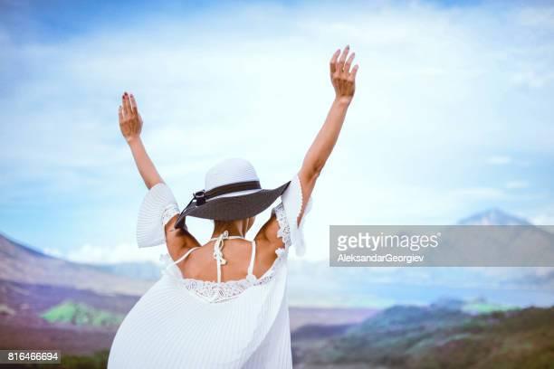 Beautiful Female Enjoying the View of Vulcano with Raised Hands