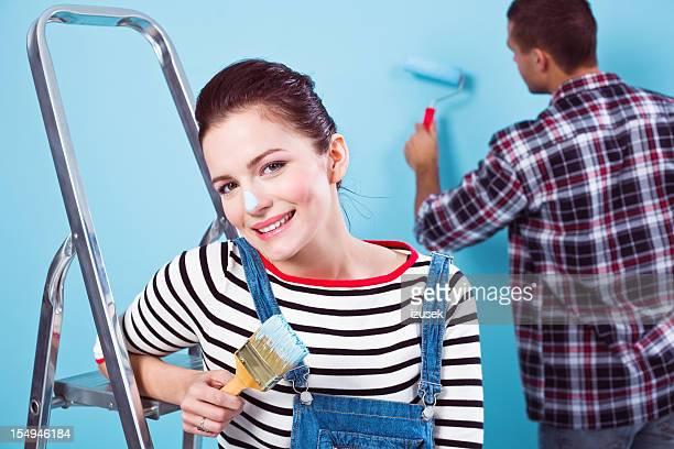 Beautiful female house painter