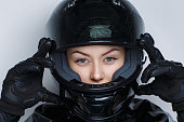 Closeup portrait beautiful girl woman lady wearing moto helmet. Luxury black color leather material, magazine styling. Bright shiny shadows make up. Professional photo model person horizontal banner