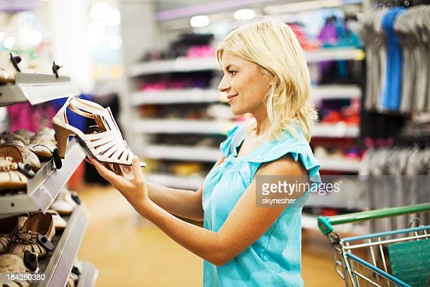 Beautiful female shopping for shoes.
