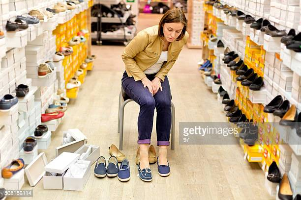 Beautiful female shopping for shoes