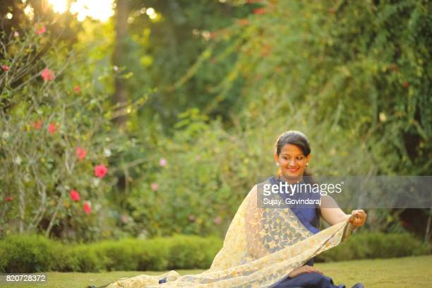 Beautiful Female Sitting on Grass Bed