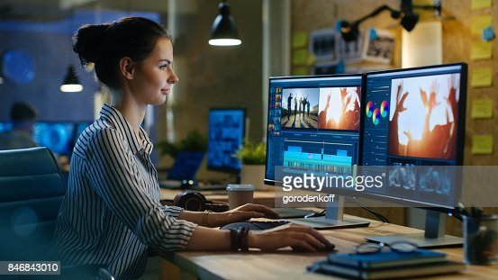 Beautiful Female Video Editor Works with Footage on Her Personal Computer, She Works in Creative Office Studio. : Stock Photo