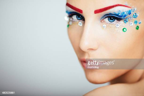 Beautiful female with extreme makeup