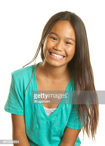 Beautiful Filipino Girl on a White Background Smiling : Stock Photo