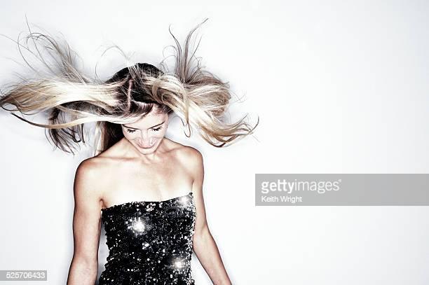 Beautiful fit blonde woman dancing.