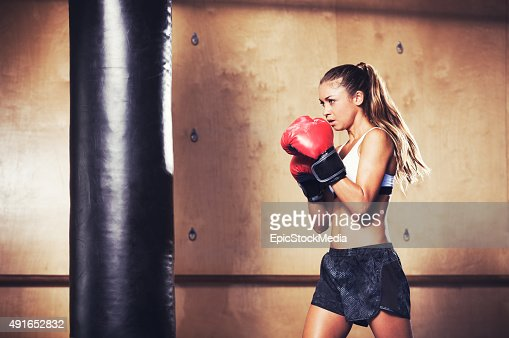 Beautiful Fitness Woman Boxing with Red Gloves : Stock Photo
