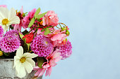 bunch of beautiful flowers on blue background