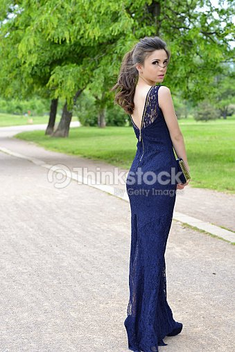 Beautiful Formally Dressed Young Woman Standing Outside In Park