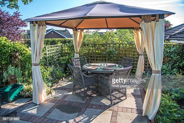 Beautiful Garden with pegola and table