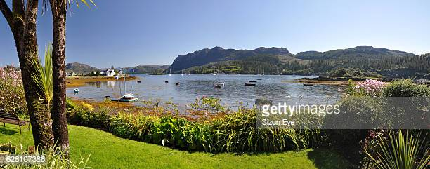 Beautiful garden with view over Loch Carron in Plockton in Highlands of Scotland.