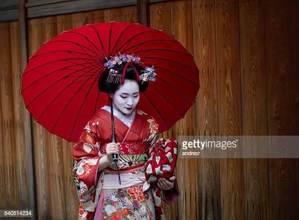 Beautiful Geisha walking through Kyoto