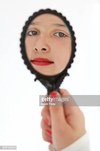 Beautiful girl admiring herself in mirror