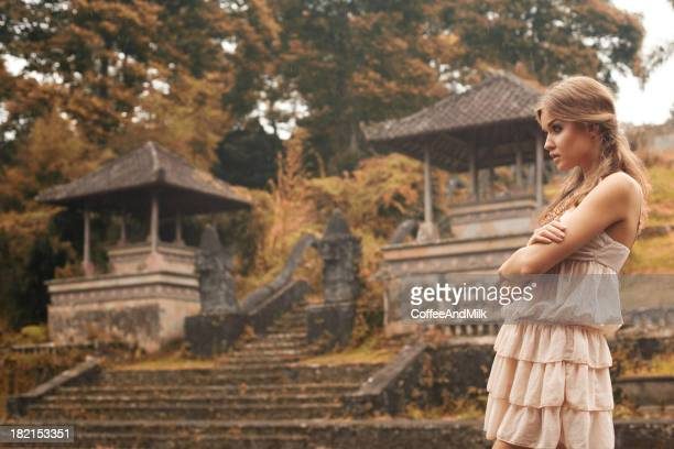 Beautiful girl and Chinese landscape