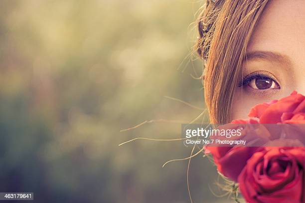 Beautiful girl and red roses.