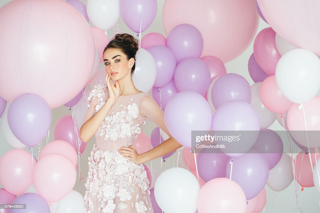 Beautiful girl at the studio with balloons : Stock Photo