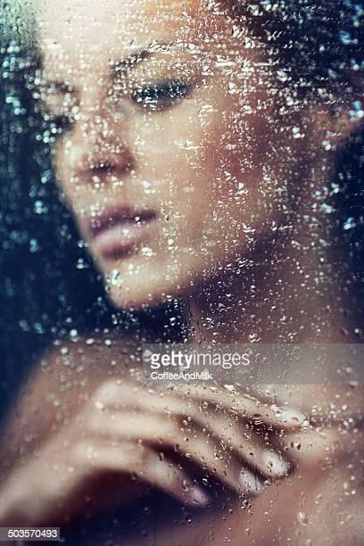 Beautiful girl behind a window