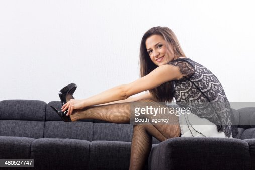 Beautiful girl chooses shoes in room : Bildbanksbilder