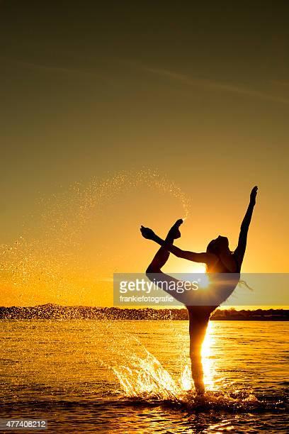 Beautiful girl dancing in the sunlight