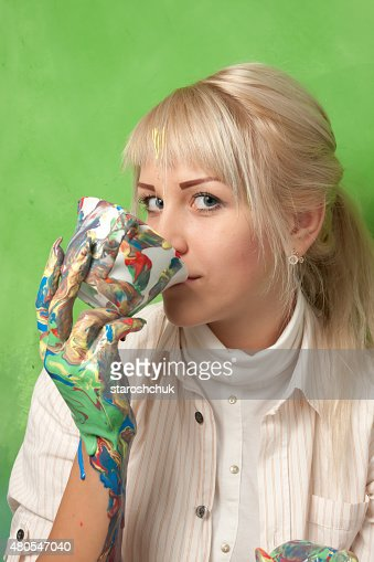 Beautiful Girl Drinking from a Smudged Cup : Stock Photo