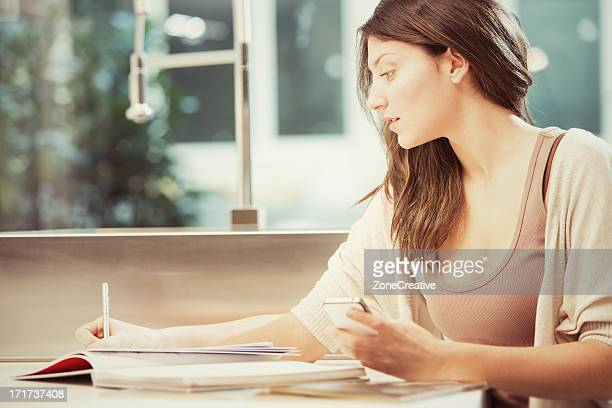Beautiful girl enjoys tecnology at home in evening